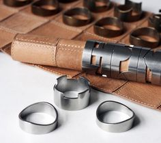 This fancy chess set is made using a suede leather board along with ring-like playing pieces that allow you to roll up the leather board and put the chess pieces around the board to keep it fastened. ...