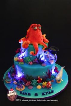 This cake took over a month's planning, designing and prep. My kids were so into this movie and with a sweetheart like Dory I def wanted this cake to be right in all ways. Hank on the top is all sugar paste and so are all the corals and sea...