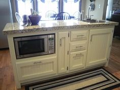 Kitchen island with microwave Old Sweetwater Cottage
