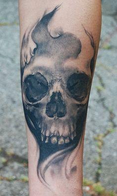 Unique Grey Ink Skull Tattoo On Arm