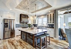 Kitchen with barn wood island. #Kitchen Barn Wood Kitchen island #BarnWood #BarnWoodKitchenIsland  Dwellings Inc.