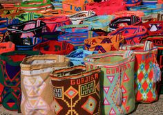 Mochila bags are made by Wayuu Tribeswomen, an indigenous people who live near the borders of both Colombia and Venezuela. Art And Illustration, Mochila Tote, Trip To Colombia, Indie, Puzzle Of The Day, Tapestry Crochet, Textile Art, South America, Latin America