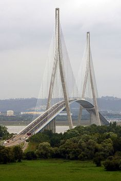 Pont de Normandie - The Pont de Normandie is a cable-stayed road bridge that spans the river Seine linking Le Havre to Honfleur in Normandy, northern France. Its total length is 2,143.21 metres (7,032 ft) – 856 metres (2,808 ft) between the two piers.