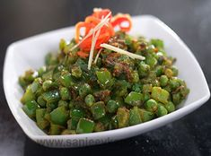 The flavours of capsicums and green peas mingle well in this stir-fry.