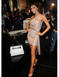 Look at that gorgeous dress. Victoria Beckham