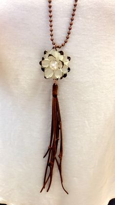 Fun long necklace with leather tassel! Find at www.cindysfaves.com #cindysfaves
