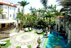 Dark past: It was outside this house where legendary designer Versace was killed by a lone gunman