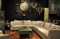 Cream couch against dark wall