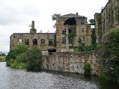 Derelict building by the Leeds and Liverpool Canal, Burnley .The picture shows the rear of Victoria Mill.The mill is located in the Weavers Triangle area of town. It was built in 1854 for Edward Stocks Massey and contained between 18,000  and 20,000 spindles