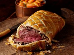 Beef Wellington - the crust looks delicious with the golden color and cross marks.