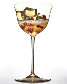 Champagne Gelee Cocktail: white grape juice,  champagne (prosecco or cava), st germain liqueur.  add pomegranate seeds for garnish.