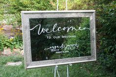 Silver leaf framed custom painted wedding welcome mirror. Couple's name art copied from wedding invitation.