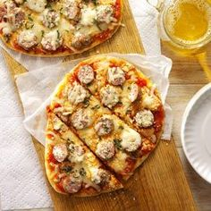Grilled Sausage-Basil Pizzas Recipe -These easy little pizzas are a wonderful change of pace from the classic cookout menu. Let everybody go crazy with the toppings. —Lisa Speer, Palm Beach, Florida