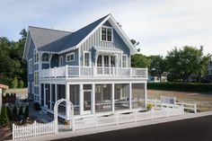 This Craftsman house plan has 4 bedrooms, 3 bathrooms, and a 2 car rear entry garage. This home plan is featured in the Cottage, Unique House Plans and View Lot House Plans collections. Beach Cottage Style, Beach Cottage Decor, Coastal Cottage, Coastal Homes, Lakeside Cottage, Modern Cottage, Coastal Living, Coastal House Plans, Beach House Plans