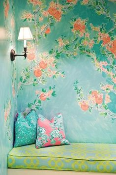 Girly chic pretty Mediterranean  upholstered yellow blue regency print day bed bench seat lounge with floral green blue wallpaper & pink & green throw accent cushions