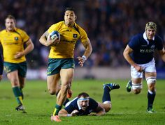 Israel Folau bursts clear to score Australia's opening try against Scotland