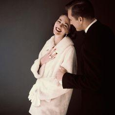December 1954 by Leombruno Bodi    Model is wearing a white Canadian beaver jacket with Hattie Carnegie earrings.