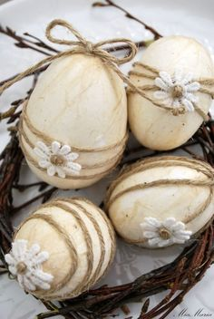 Coffee dipped Easter eggs wrapped with twine (use a drop of glue), & embellished with tiny flowers.