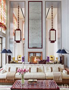 O'Keeffe custom designed almost all of the home's furniture and fabrics. The drawing room is anchored by a double sofa upholstered in ivory and multicolor-stripe fabrics; the floor lamps with pleated-silk shades are by Charles Edwards.