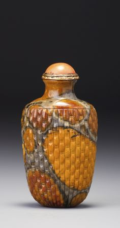 A PUDDINGSTONE 'BASKET-WEAVE' SNUFF BOTTLE<br>QING DYNASTY, 18TH CENTURY | Lot | Sotheby's