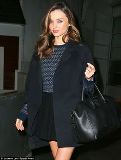 Blue is the colour: Miranda Kerr looked stunning in a navy coat, skater skirt and woolly jumper in New York on Thursday night Miranda Kerr, Olivia Palermo, Sixth Form Outfits, Skater Skirt Dress, Wooly Jumper, Navy Coat, Victoria, Business Dresses, Looking Stunning