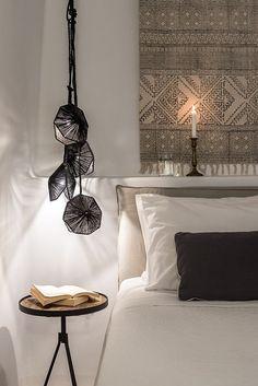 Perfect bedroom lighting Porto Fira Suites in Santorini. Interior Design by Interior Design Laboratorium. Photography by Giorgos Sfakianakis