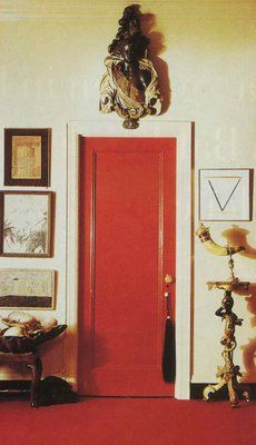 Glossy red door in the home of Diana Vreeland.