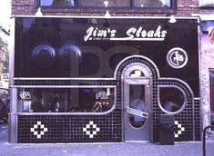 Definitely NOT vegan, but this place is the bomb. Jim's Steaks for a classic Philly Cheese Steak. South Street, Philly.