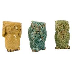 "Hear No Evil, See No Evil and Speak No Evil.  says the owle that can get to the center of a tootsipop in three licks....Set of three ceramic owl statues.   Product: 3 Piece owl décor setConstruction Material: CeramicColor: Yellow, blue and greenDimensions: 6.5 H x 3.75"" Diameter each"