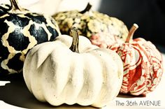 How to give a bunch of Dollar Store or old pumpkins the WOW look using fabric and Mod PODGE. Cute!