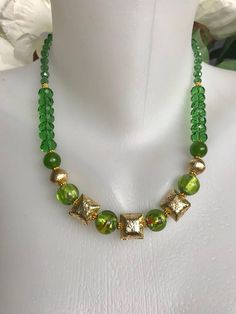 Beautiful sparkly necklace, catches light beautifully, square gold filled beads 12mm (depth 6mm) 10mm hand made foil glass beads, 8mm round gold filled beads, 8mm round jade beads, gold filled daisy rings, 8x5mm faceted electroplated glass beads, 5x4 tear drop electroplated glass beads with