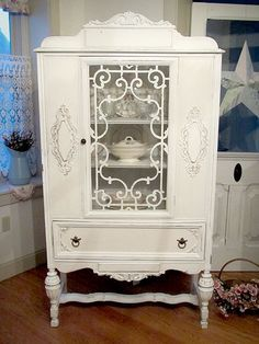 China cabinet - Refinished for a shabby chic look - fretwork behind glass door & scrollwork / Forever Pink Cottage Chic - A boutique situated in Chester Heights, PA inside an 18th century Victorian home that offers romantic vintage decor items.