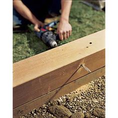 """Drill 1/2"""" weeping holes along sides every 4'. Drill from inside of bed towards outside & angle slightly downward to the outside. Slip 3/8"""" copper or PVC tubing into weeping holes to protect wood and help keep hole clear."""