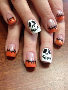 Wonderful Halloween nail art on orange acrylic tips.