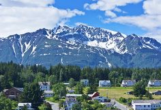 Beautiful mountains overlooking quaint towns. You don't have to travel far to find wilderness in Alaska. http://www.hollandamerica.com/cruise-destinations/alaska-cruises?WT.mc_id=SM_Pinterest