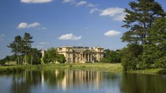 The south front of the house seen across the lake at Croome Park, Croome D'Abitot, Worcestershire. Capability Brown remodelled the exterior facades of the house in Classical Palladian style, and added wings to the east and west in 1752. © NTPL/Andrew Butler