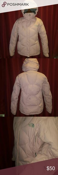 North face down jacket Dusty rose down jacket Zip removable hood Side zipper vents to cool you down Arm/wrist pocket (chap stick?) Inside snap snow gourd Goggle pocket inside and additional zip pocket Fleece lined neck Hood and waist cinched Ear bud hole and place holder Velcro sleeve closure   Small stain  right chest, and back (pics included. I think from ski lift. North Face Jackets & Coats Puffers
