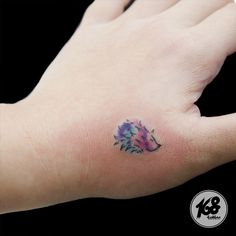 small watercolor Hedgehog tattoo on arm