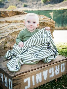 """Swaddling Blanket-Organic (Sage & White) by L'ovedbaby, $24.99 FREE SHIPPING! At 37"""" x 37"""", this roomy swaddling blanket is a must-have. Its soft organic cotton and great stretchability (up to 45"""") makes for easy swaddling that stays put. Our L'ovedbaby™ logo, embroidered in 2 neutral colors, delivers an extra touch of style. Available in 8 solid colors and 5 stripe prints.  #blanket #babyblanket #organic #organicbaby #organicbabyclothes #babyclothes #lovedbaby"""