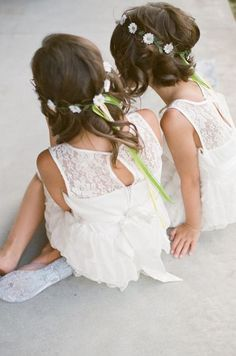 Adorable flower girls with delicate hair garlands.