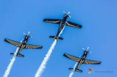 Airshow, Two Planes Upside Down and One Upright