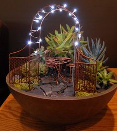 Fairy garden all lit up with mini lights for the fairies!