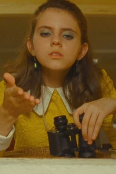 The Wild Child: Kara Hayward in Moonrise Kingdom  The Beauty Mark: Hayward's Suzy shows an impressive mastery of eye makeup application (pulling off blue eye shadow is no small feat). But this girl is hardly high-maintenance; when she runs away from home to be with her beloved Sam, she leaves behind all her beauty products in favor of a suitcase full of books, a record player, and her kitten.