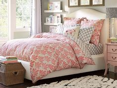 No elephants! but love the wicker basket and the hanging shelves! Wanting this comforter and sheet set for my bedroom. Not too young, but still cute, and could have for a long time based on age style.