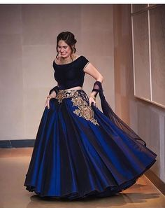 Love this plain yet modern lehenga outfit- love the navy velvet with a touch of embroidery; perfect for an indian wedding event Indian Gowns, Indian Attire, Pakistani Dresses, Indian Wear, Indian Outfits, Red Lehenga, Bridal Lehenga, Lehenga Choli, Bollywood Lehenga