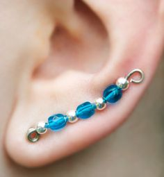 Silver twisted wire and blue glass bead ear sweeps - large