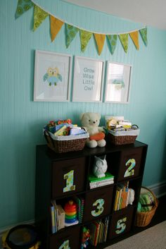 bookshelf, pictures and bunting
