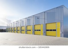 Industrial Warehouse Yellow Roller Doors : photo de stock (modifier maintenant) 76695253 Industrial Sheds, Parque Industrial, Industrial Architecture, Industrial Park, Bamboo Architecture, Conception D'entrepôts, Pre Engineered Steel Buildings, Roof Cladding, Cladding Ideas