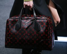 "Louis Vuitton's Spring 2015 Bags Show Nicolas Ghesquiere Coming Into His Own | ""Another first: A red and black monogram print...Overall...plenty to look forward to."""