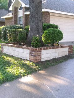 This is a beautiful stone and brick planter GroundScape installed in Hurst Texas. If you would like a quote for this new addition to your home, give us a call at Flower Bed Edging, Flower Beds, Brick Planter, Planters, Hurst Texas, Landscaping Company, Brick And Stone, Garden Beds, The Great Outdoors